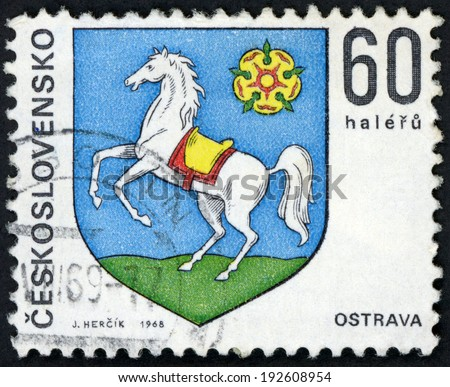 CESKOSLOVENSKO - CIRCA 1968: post stamp printed in Czechoslovakia (Czech; Slovakia) shows coat of arms of regional capitals; Ostrava; white horse; Scott 1575 A590 60h blue green white, circa 1968 - stock photo
