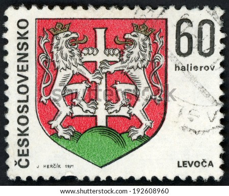 CESKOSLOVENSKO - CIRCA 1971: post stamp printed in Czechoslovakia (Czech; Slovakia) shows coat of arms of regional capitals; Levoca; two lions holding cross; Scott 1743 A590 60h red green, circa 1971 - stock photo