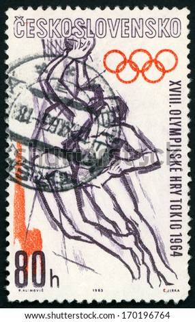 CESKOSLOVENSKO - CIRCA 1963: stamp printed in Czech republic (Czechoslovakia) shows men playing basketball, 1964 Olympic games Tokyo; sports series; Scott 1205 A463 80h gray purple orange, circa 1963 - stock photo