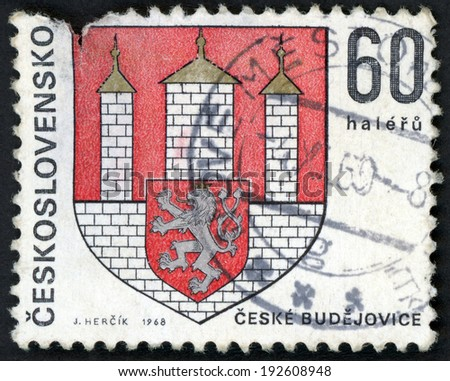 CESKOSLOVENSKO - CIRCA 1968: stamp printed in Czechoslovakia (Czech) shows coat of arms of regional capitals; Ceske Budejovice; 3 towers & shield with lion, Scott 1572 A590 60h red white, circa 1968 - stock photo