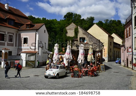 CESKY KRUMLOV, CZECHIA- AUGUST 11: Unidentified tourists, restaurant and buildings in the Unesco World Heritage site in Bohemia, on August 11, 2013 in Cesky Krumlov, Czech Republic