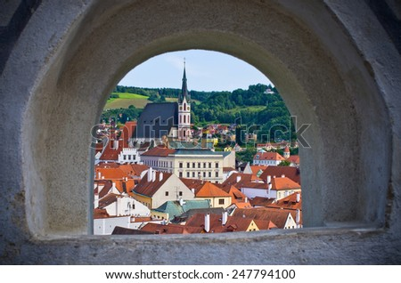 Cesky Krumlov in the stronghold wall window - Czech Republic - stock photo