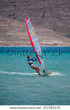 CESME -TURKEY - JULY 21: Unidentified of windsurfing sailor on training session for participate in Cesme of sports on July 21 2012 in Cesme, izmir, Turkey
