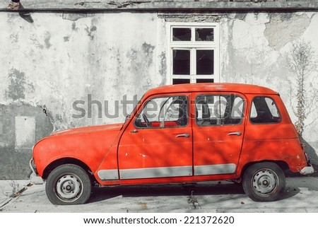 CETINJE, MONTENEGRO - AUGUST 25. Red the Retro the Renault car on the street of Cetinje on August 25, 2014. Cetinje historical capital of Montenegro. - stock photo