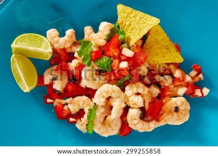 Ceviche de Camaron shrimp mexican food on blue plate - stock photo