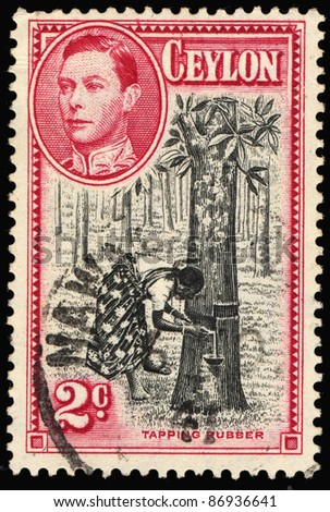 CEYLON - CIRCA 1949: A stamp printed in the Ceylon shows image of a person tapping rubber, series, circa 1949