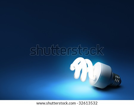CFL bulb on dark blue backdrop with copy space - stock photo