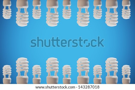 cfl bulbs on blue background - stock photo