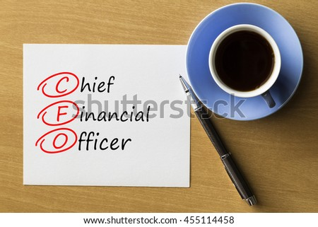 CFO Chief Financial Officer - handwriting on notebook with cup of coffee and pen, acronym business concept