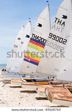CHA-AM THAILAND - AUGUST 22: A group of unidentified sailboats park on a beach during Day 1 of 2011 Hua Hin Regatta on August 22, 2011 at Dusit Thani Resort & Spa Hua Hin in Cha-Am, Thailand
