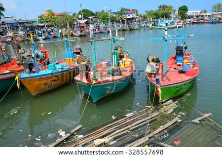 CHA-AM,THAILAND-OCTOBER 18 : Fishing boat  harbour them boat at dock on OCTOBER 18,2015 in CHA-AM beach, Phetchaburi Province, Thailand.