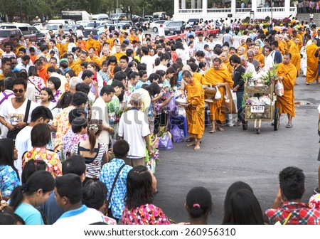 Chachoengsao,Thailand- April 13,2014 : Thai people offerings food to a Buddhist monks on Songkran day in Chachoengsao province,Thailand.  - stock photo