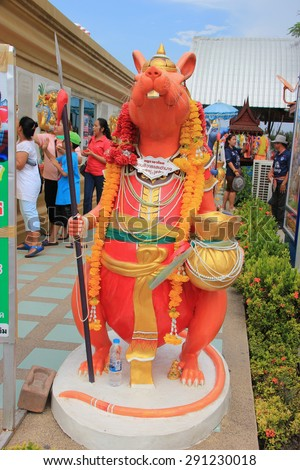 Chachoengsao, Thailand - May 4, 2015: Mouse is Lord Ganesha's Mount. Wishing that their wishes will be conveyed to the God, people whisper into the mouse's ears while placing a hand over other ear. - stock photo