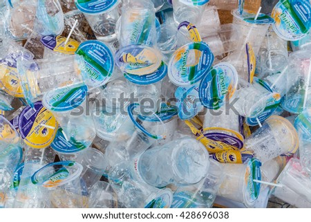 Chachoengsao, Thailand - May 28th, 2016 : Disposable plastic cups different kinds waste gathered separately in waste containers for recycling of plastic saves at Wat Hong Thong, Chachoengsao, Thailand - stock photo