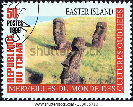 "CHAD - CIRCA 1999: A stamp printed in Chad from the ""Wonders of Forgotten Cultures"" issue shows Easter Island, circa 1999.  - stock photo"