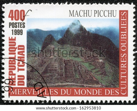 """CHAD - CIRCA 1999: A stamp printed in Chad from the """"Wonders of Forgotten Cultures"""" issue shows Machu Picchu in Peru , circa 1999. - stock photo"""