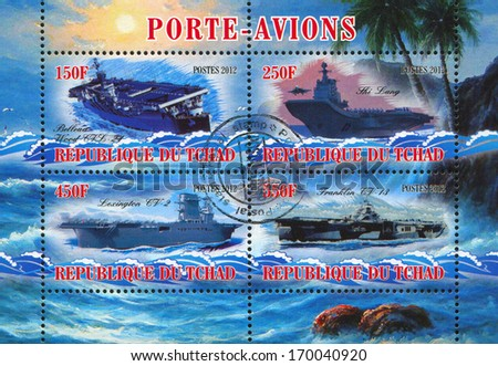 CHAD - CIRCA 2012: stamp printed by Chad, shows aircraft carrier, circa 2012 - stock photo