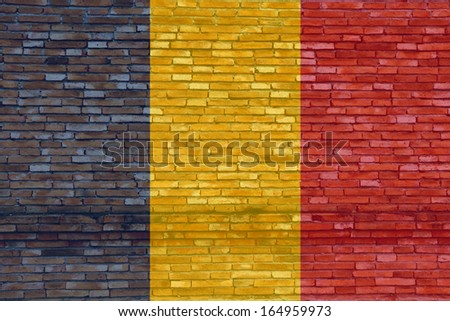 Chad flag on texture brick wall.