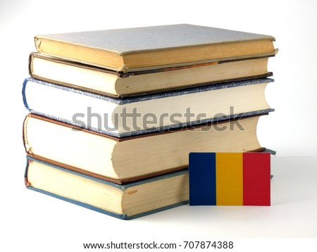 Chad flag with pile of books isolated on white background