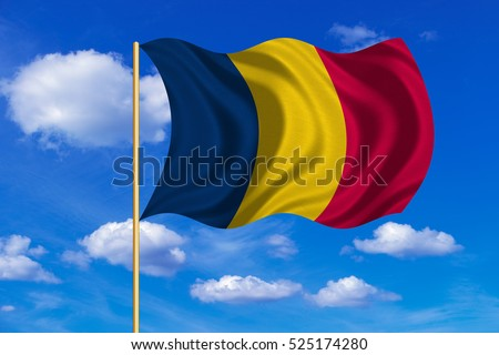 Chadian national official flag. African patriotic symbol, banner, element, background. Correct colors. Flag of Chad on flagpole waving in the wind, blue sky background. Fabric texture