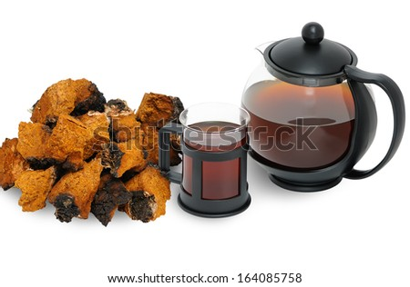 Chaga mushroom. A medicinal drink and chopped into pieces Chaga - stock photo
