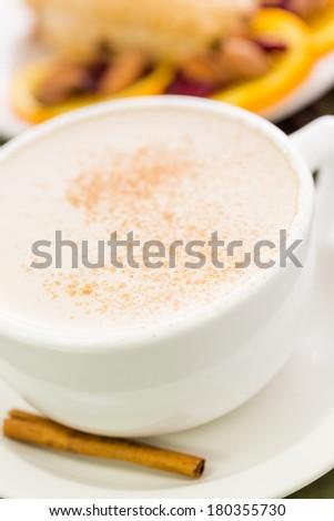 Chai tea latte withcranberry orange fresh scone for breakfast. - stock photo