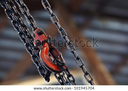 Chain and Red hoist on background - stock photo