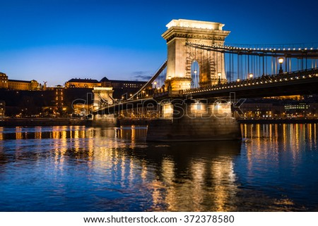 Chain bridge in Budapest, Hungary, Europe. Blue hour in city. Sky and lights reflecting in waters of Danube river. Major Landmark and tourist attraction.