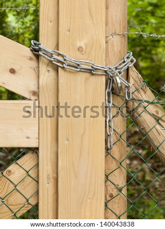 Chain hanging on a abandoned gate (Holland) - stock photo