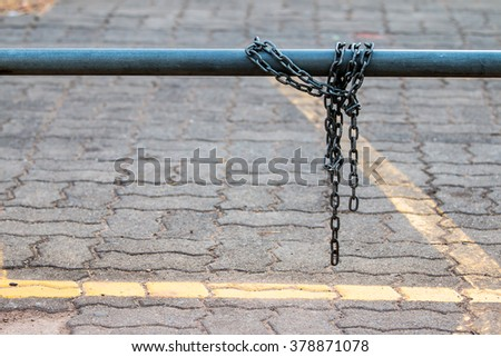 Chain laid across  steel lock for bicycles, motorcycles lost.