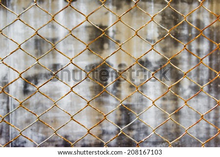 Chain link fence against wall background