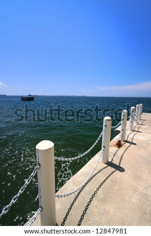 chain linked shipping dock - stock photo