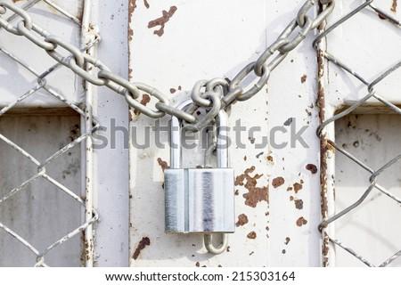 chain lock the door - stock photo
