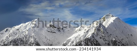 chain of mountains in the winter - stock photo