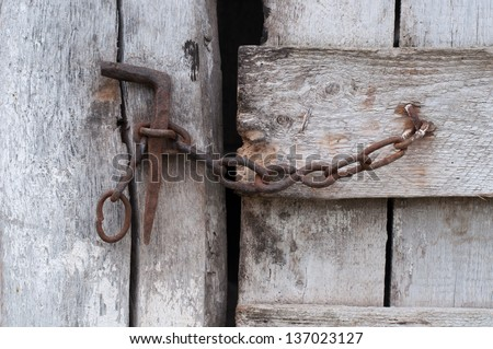 Chain on an old wooden door