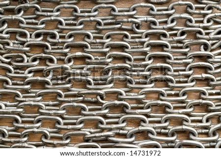 Chain on wooden surface background - stock photo