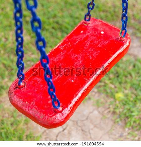 Chain swing in children playground - stock photo