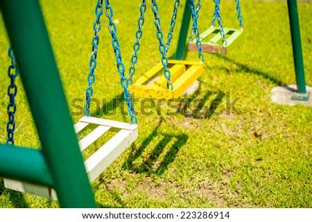 Chain swing in children playground. - stock photo