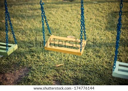 chain swing in garden. Retro style - stock photo