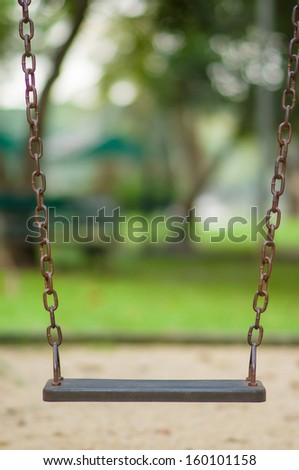Chain swing on kids playground - stock photo