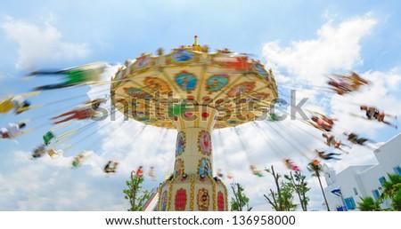 Chain swing ride in amusement park   - stock photo