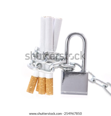 chain with padlock around cigarettes isolated on white background - stock photo