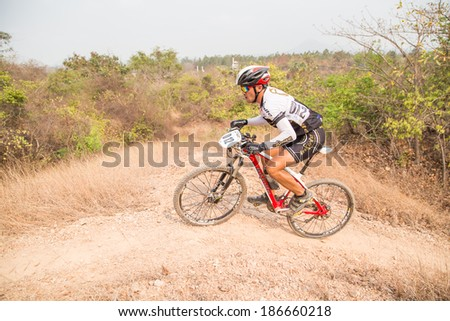 CHAINAT, THAILAND - MARCH 9 : An unidentified athlete riding a Mountain bike Cross country at Thailand Championship 2014 Race 3 on March 9, 2014 at Khaoprong Track in Chainat, Thailand.