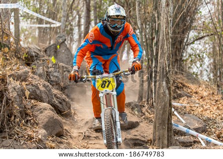 CHAINAT, THAILAND - MARCH 9 : An unidentified athlete riding a Mountain bike down hill at Thailand Championship 2014 Race 3 on March 9, 2014 at Khaoprong Track in Chainat, Thailand.