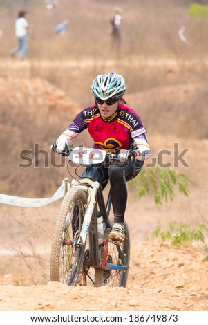 CHAINAT, THAILAND - MARCH 9 : Unidentified athletes riding a Mountain bike Cross country at Thailand Championship 2014 Race 3 on March 9, 2014 at Khaoprong Track in Chainat, Thailand.