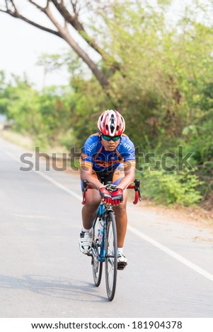 CHAINAT, THAILAND - MARCH 9 : Unidentified athletes riding a Road bike at Thailand Championship 2014 Race 3 on March 9, 2014 at Khaoprong  in Chainat, Thailand.