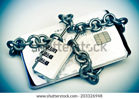 chained credit cards security lock with password - phishing protection concept - stock photo