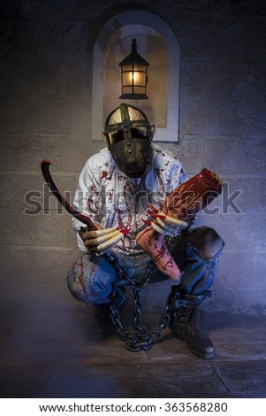 chained monster with bloody claw, claws and bloody clothing - stock photo