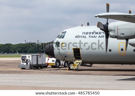 Chaing Mai  Thailand 25 august 2016 : C-130  from Royal Thai air force was changing its battery by electric car while The L-39 albratos  was taking off at Chaing mai airport.