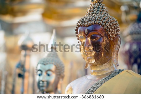 CHAING MAI,THAILAND-JANUARY 18,2016 : Face of standing outdoor Buddha at golden Pagoda of Wat Phra That Doi Suthep,The temple is founded in 1383 when the first stupa was built,in Chaing Mai,Thailand. - stock photo